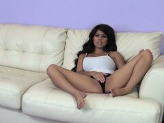 Sexy brunette Latina Layla Rose puts on a hot striptease on the couch