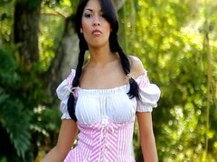 Pretty Latina takes off her dress and plays with her muff
