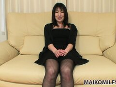 Sexy Milf sits on the couch talking, then starts to undress for fun