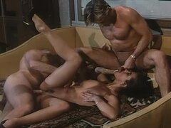 Brunette Handles Two Cocks in Double Penetration Vintage Italian Threesome