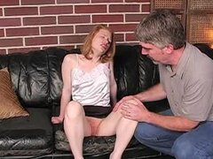 Redhead in satin top spanked hard