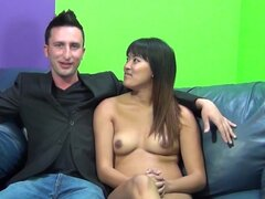 Thai girl gets banged doggy style on the sofa
