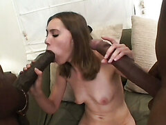 Blindfolded young chick gets caught in the middle of two gigantic dicks