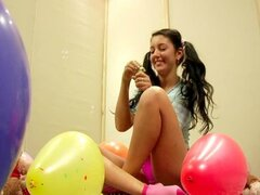 Teen with teddy bears and balloons