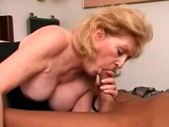 Big haired mature blonde sucks dick
