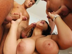 Kristi displays her blowjob abilities, eager to have those dicks banging her holes