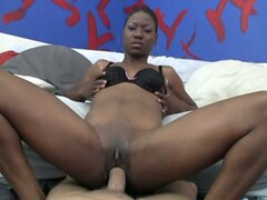Luscious ebony whore stretching pussy with huge white cock
