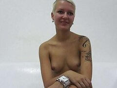 Short haired teen blonde with tattooes strips and poses on casting