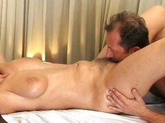 Beautiful MILF has her hairy pussy massaged