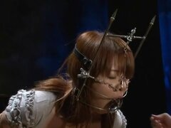 Japanese girl drools out of her gag