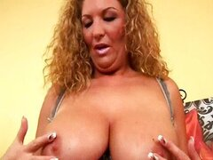 Chubby woman with big tits dildoing