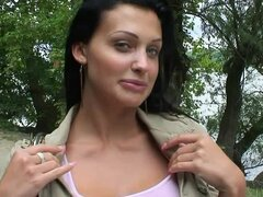 Playful Aletta Ocean shows her big fake tits outdoors