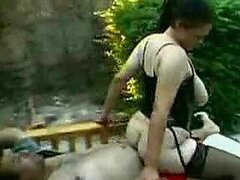 A bold Arab mom films herself getting nasty in the garden with a younger guy