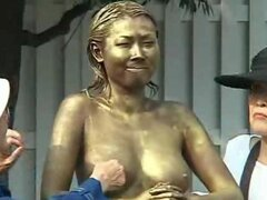 A Japanese pornstar is has her entire body painted emerald including asshole and then placed in a real public park to the delight of spectators