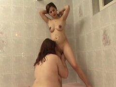 2 Pregnant Lesbians Play in the Tub