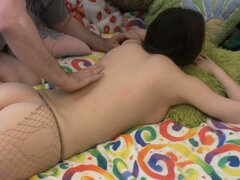 Megan lies down while he rubs his hands all over her in a massage