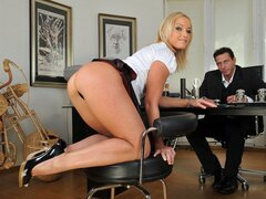 A Blonde slut and a dude are all dressed up in the office. She bends over like a true pro