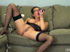Tory Lane uses her purple cock in her pussy and sucks off the juices