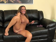 Richelle Ryan has a good old time posing and masturbating on the couch