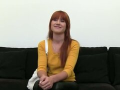 Redhead princess finger on black couch