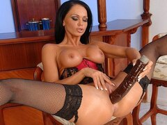 A banging hot brunette chick has found a huge brown dildo and she's ramming her hole with it