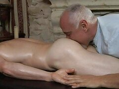 Older gay daddy gives young handsome guy a full body massage