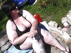 Pale cutie masturbates in nature