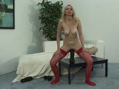 Blond bitch in red stockings plays with huge toys