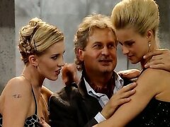 Two beautiful blonde European babes fucking some lucky dude in a threesome scene.