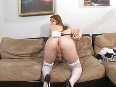 Teen trannie in maid costume masturbates on couch