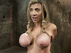 Blonde milf gets her big pretty tits bound and pulled up
