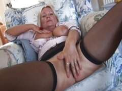 Busty mature babe in mini skirt strip