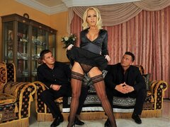 A blonde hottie dressed up in sexy, black lingerie tries her first threesome with two guys