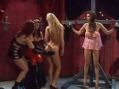 Busty Brunette Dominatrix Wraps Up Submissive Lesbian Female in Latex