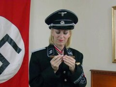 Nazi girl Morina in ss uniform smokes a cigar and masturbates