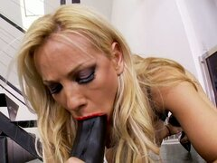 Vega Vixen blonde sucking a black long dildo