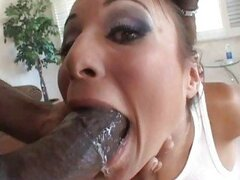 Hot girl gagging on huge black cock