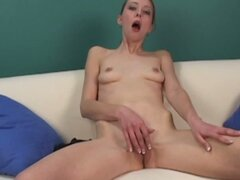Amateur brunette chick strips and rubs pussy