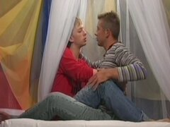 Young gay couple makes sweet love in bed