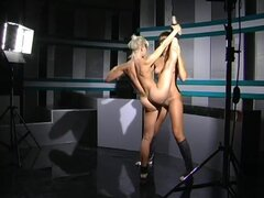 Sporty naked girls practice their balance together