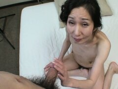 Nobue pleases her snatch with a vibrator before wrapping her lips around his shaft