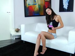 Solo girl Marya in black panties is satisfying her shaved love tunnel on the sofa