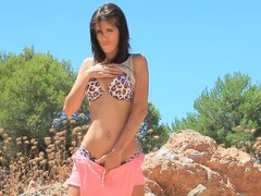 Pretty chick Carla shows off her naked slender body