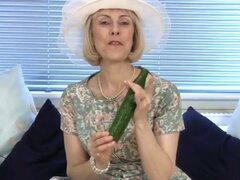 Horny granny takes a cucumber down her wet...