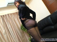 Sexy Asian milf drops her clothes to reveal her fabulous ass...