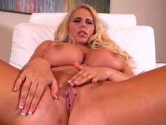 Big boobs blonde in solo action