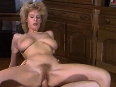 Retro porn video with Desiree Barclay sucking cock...