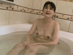 The hot cougar gets in the bathtub and takes her time soaping her hungry snatch