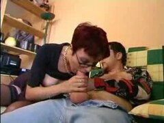 Short haired redhead with glasses pleasures her lover