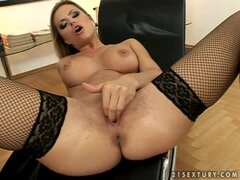 Stunning blonde in fishnets masturbates in the office